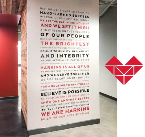 Harkin's brand story applied to office wall as an environmental graphic